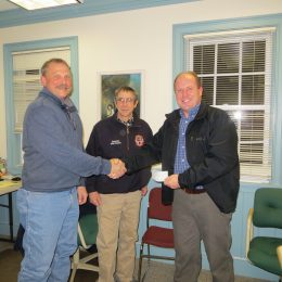Mark Placek of Berkshire Trail Riders (left) presents Grant to Fire Chief Scott Loomis (right) of Granville Fire Department while Deputy Chief Wesley Bauver looks on.